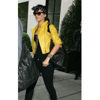 Rihanna Yellow Leather Jacket with a Ruffled Collar